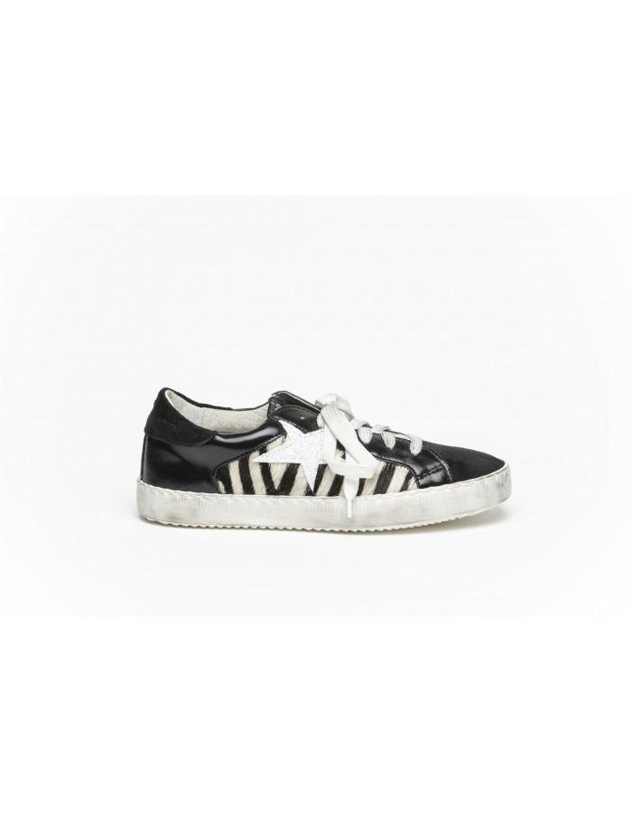Sneakers zebrata e crosta nero laminato Ovyè